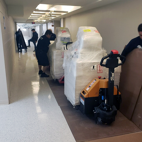 Medical Equipment Arriving at Hospital for Installation on Dolly